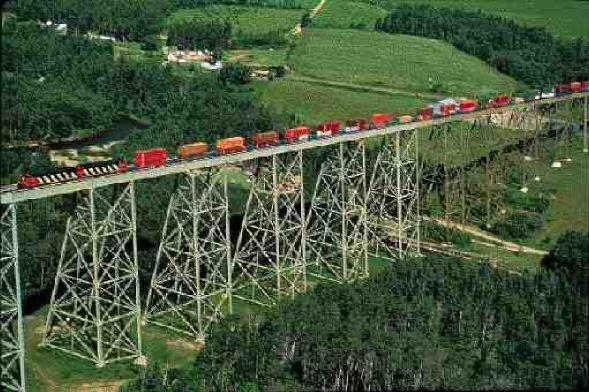 A CN train of double-stacked containers crosses the Salmon River Bridge near Grand Falls in New Brunswick.