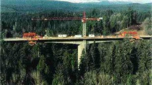 Above: bridge in harmony with natural surroundings. Right: box girder and pier form work.