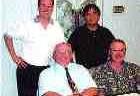 Above: Mitchell & Associates team. Back row, l to r: Ken Smith, Benny Szeto, (front row) Frank C. Mitchell, George Wright