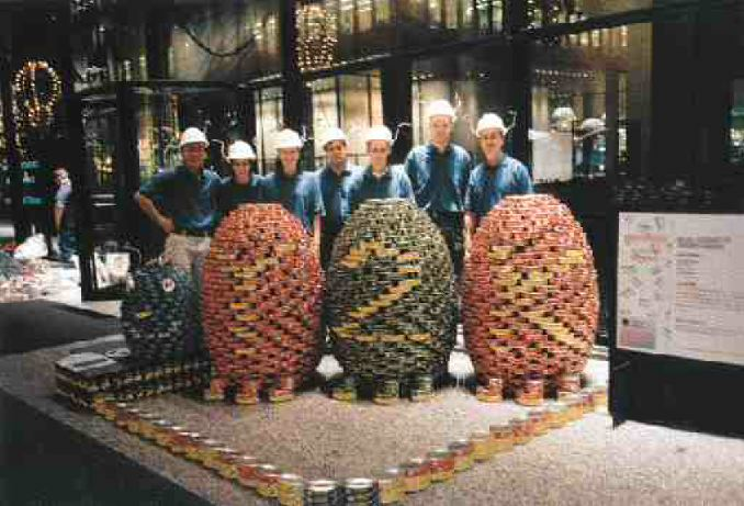 "Halsall Associates staff behind the ""Y2K Bug"" they made with food cans for the CANstruction charity event in December. The real computer bugs had evidently been squashed out of existence by the time New Year's Eve 2000 rolled around. CANstruction was partly sponsored by Consulting Engineers of Ontario. Eight teams of engineers and architects had to make an artistic creation using 32,000 tonnes of prepackaged food. The food was later donated to the Daily Bread Food Bank.LETTERS"
