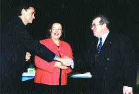 Dave Chalcroft, Vice-President UMA Engineering Ltd., (at right) accepts the honours from CIDA Minister Maria Minna and ACEC President Tim Page.