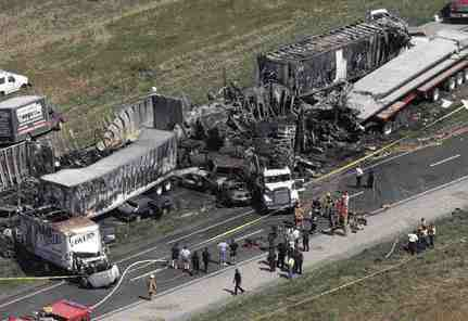 Burned and mangled vehicles strew Highway 401 near Windsor after a crash that involved at least 63 vehicles and killed seven people last September.