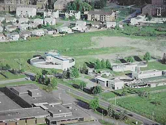 Aerial view of residential site, with original plant right foreground