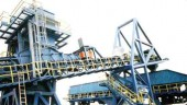 The marine leg and transfer conveyor sends coal to luffing/slewing/shuttling boom.