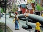 Inserting the HDPE liner pipe on a downtown street.