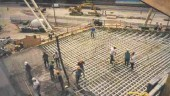 Constructing the 17 metre x 17 metre post-tensioned slab structural system.