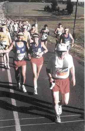 Haas (in white cap) runs in the Comrades Ultramarathon in South Africa.