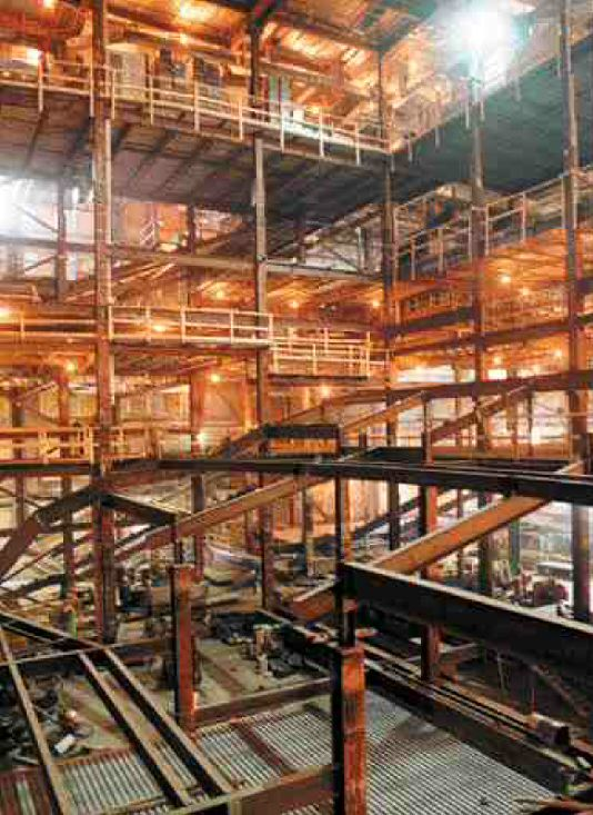 Right: construction under way. About half the columns in the structure had to be removedto open up the floors for the cinemas, including the 20 metre high IMAX screen. Confines were so tight the engineers had to raise the roof two feet and sometimes had only a couple of inches between two parallel walls.