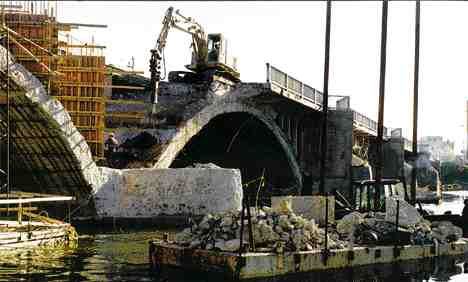 Left from top: Removing the original deck, spandrel walls and piers to the top of the arches. Reconstructing the pier cutwater and building a new deck overhang. Reconstructing spandrel walls. The new enclosed west approach with concrete-faced Terratrel wall.