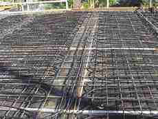 In-slab piping in place prior to pouring of concrete slab.