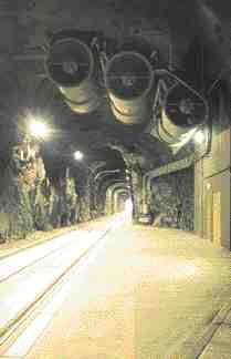 Tunnel interior safe areas (see access door at right) are located at 400 metre intervals; powerful fans purge the tunnel of smoke during a fire.