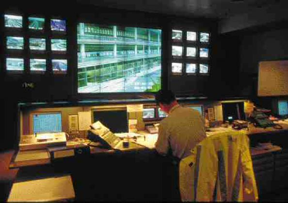 Airport landside control centre with surveillance system workstations and closed circuit television monitors. The incident detection and diversion component integrates with various operational systems of the airport.