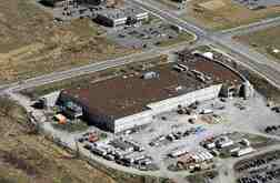 Exterior and aerial views; the facility was built as a steel structure for speed.
