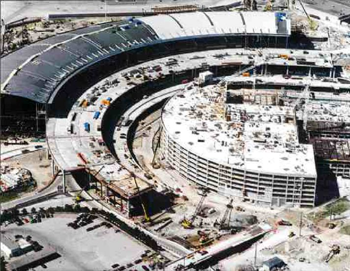 The triple deck road is staggered and integrated into the curved terminal building.