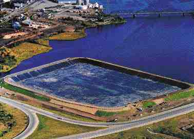 Aerial view of the lagoon with an 8-metre sea wall constructed along the Miramichi River