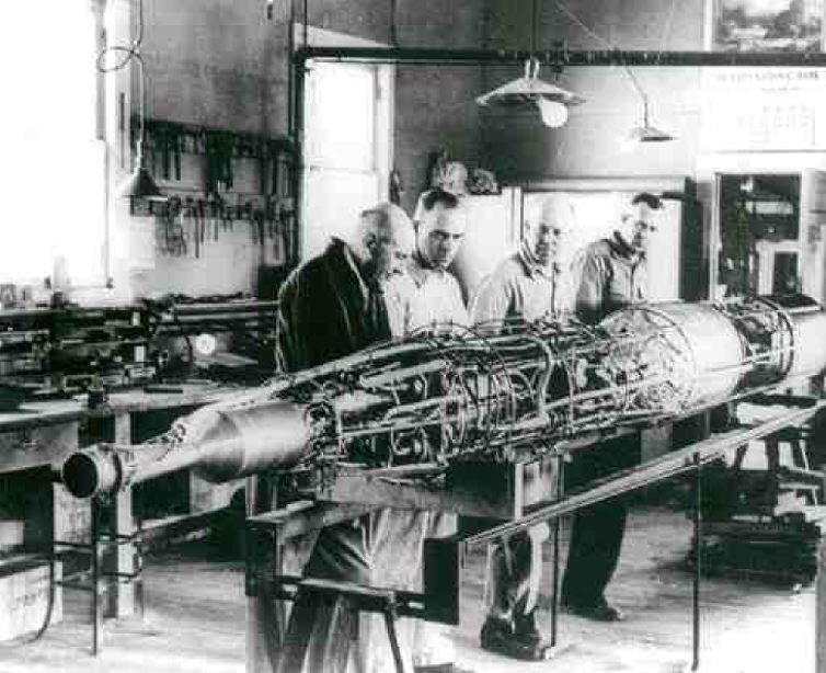 Illustrations are from the book. Robert Goddard (at left) with his 1940s rocket.