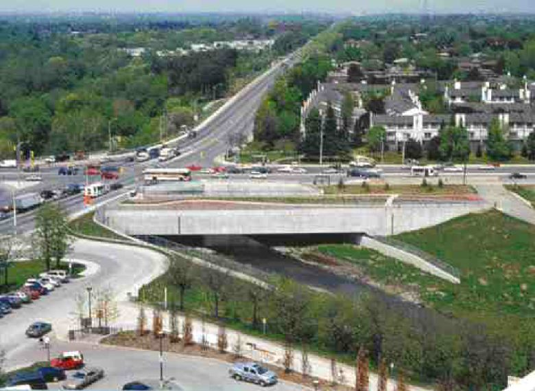 Aerial view of the enclosed train bridge, looking east.