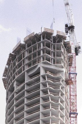Diagonal columns and outriggers at level 31. The outriggers spread the load to the building's edge.