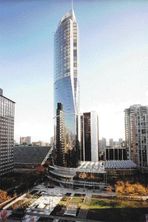 The completed tower soars above its neighbours.