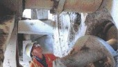 Inside the tunnel boring machine behind the cutting heads.