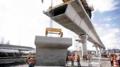 Erecting a precast concrete guideway beam segment; 50 tonnes of concrete was used to buld an average support column.