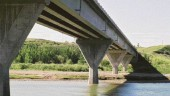 Bridge with 2800-mm deep precast concrete girder and identical splayed piers.