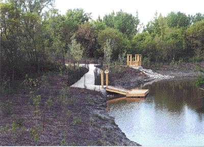 Restored riverbank with new lookout and landscape erosion protection.