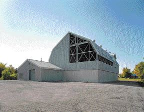 Barn-like structure blends into the rural setting. Its open walls allow for passive natural ventilation.