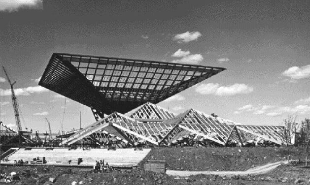 "Construction photograph of Katimavik, Canadian Government Pavilion at Expo 67 in Montreal, one of many fine archival photographs in the book. ""For a few tense moments all had nightmare images of the structure slowly turning inside out as the towers came down."""