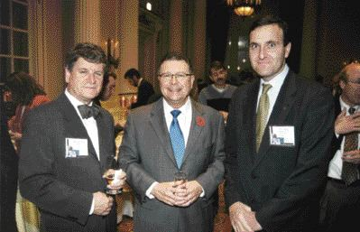 ACEC President Claude Paul Boivin (left) and ACEC Chairman Pierre Shoiry, ing., (right) greet PWGSC Minister Ralph Goodale.