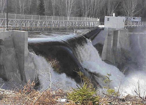 New sluiceway carrying spring run-off. The dam is on the Nepisiquit River system.