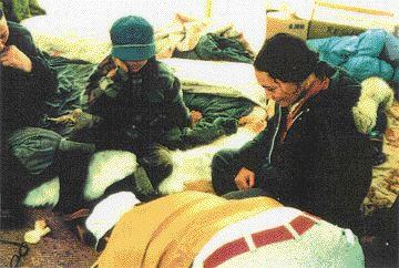 Mollard interpreting air photos inside an Inuit tent on Somerset Island in 1976.