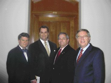 (Left to Right) ACEC President, Mr. Claude Paul Boivin; Mr. James Moore, MP and Vice-Chair of the Standing Committee on Transport; Mr. Marcel Proulx, MP and Parliamentary Secretary to the Minister of Transport; Mr. Pierre-Andr Dugas, ing., of Gnivar.