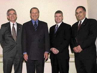 (Left to right): CEO Chairman, John Sutherns; Ontario Premier Ernie Eves; CEO President, John Gamble; Past CEO Chairman, Norm Huggins.