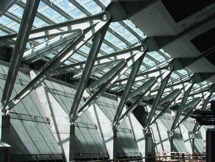 """Exposed steel """"wishbone"""" assemblies, splayed and forming part of the terminal's roof's lateral resistance system."""