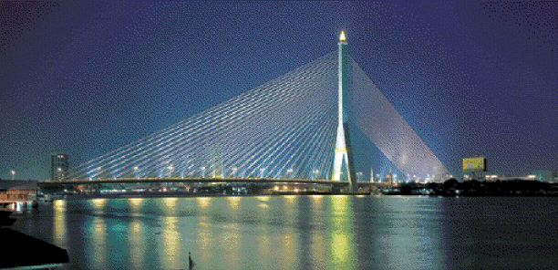 Night view of the bridge, which has a main span 300 metres, and a total span of 475 metres, supported by a 160-metre tall inverted Y-shaped tower. The structure is one of the world's longest asymmetric cable-stayed crossings.