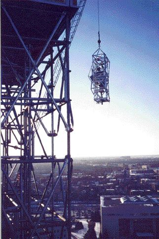 The statue is lowered down in a special cradle in February 2002.