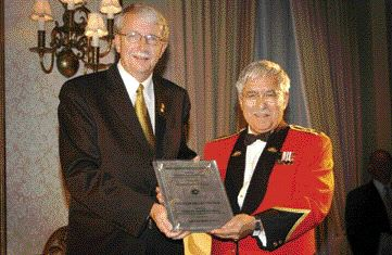 ACEC Chairman Garry Bolton presents the Award to Brigadier-General Jerry Silva.