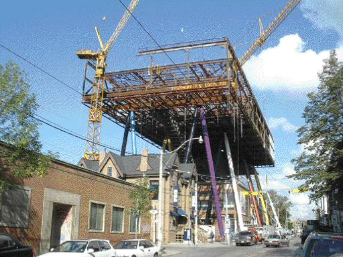 """The """"flying rectangle"""" at the Ontario College of Art and Design looms over McCaul Street as construction got under way this summer."""