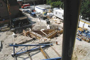 Massive triangular caissons resting on bedrock 18 metres below grade support the rectangle's splayed legs, photo RYW.