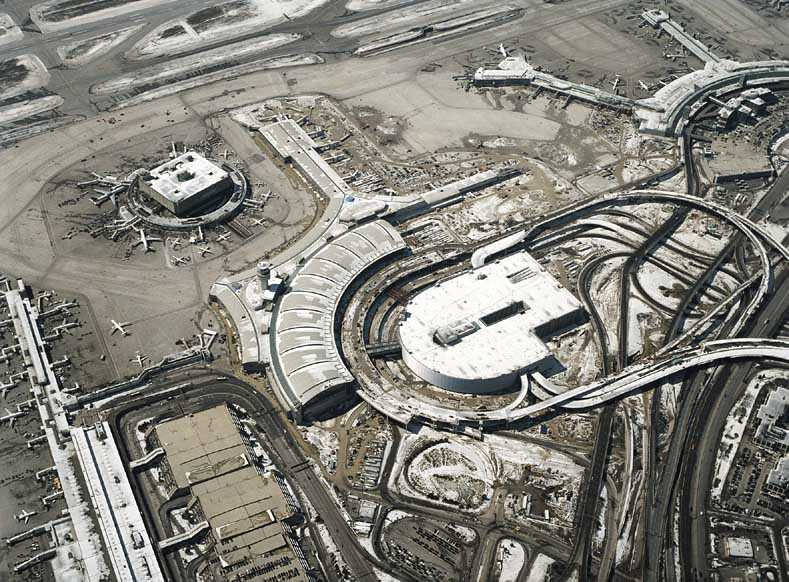 New parking garage at Pearson International Airport in Toronto dwarfs the old Terminal 1, due to demolished, at left of picture.