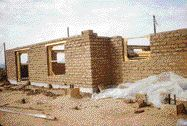 Heavy mass adobe style house with integrated radiant cooling and heating system built in Arizona.