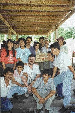 Manz (centre) with students in Indonesia celebrating construction of a concrete filter.