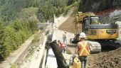 Construction of a test section of the Sea-to-Sky Highway north of Horseshoe Bay, B.C. Associated Engineering did the engineering design; SNC-Lavalin is the owner's engineer for the entire route.