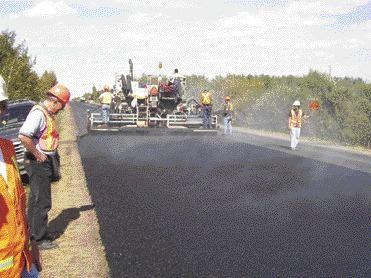 Paving Edmonton's 50th Street with asphalt rubber concrete. Source: EBA