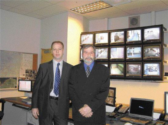 Dave Loban (left) and Graham Kee (right) at the Vancouver Port Authority command centre.