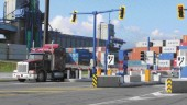 trucks pass through a checkpoint.