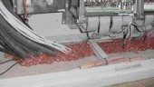 Fire-resistant foam forms the firestop around wires in a floor.