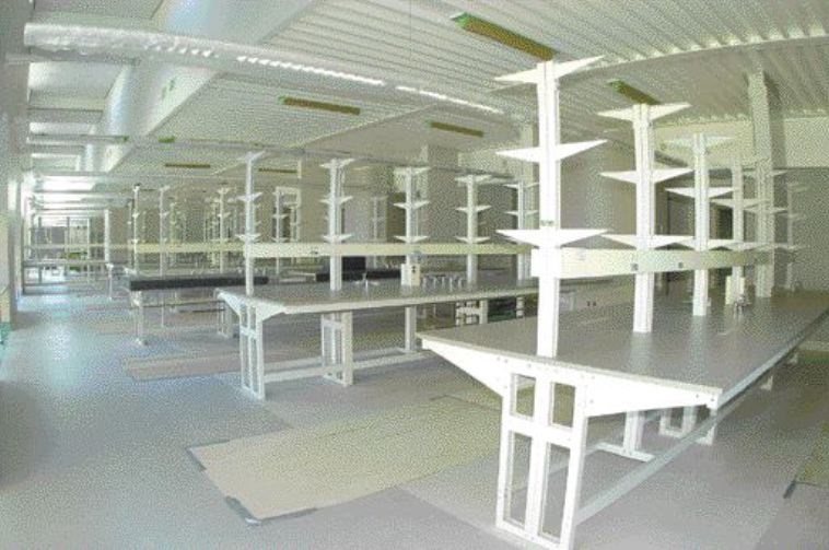 laboratories; ventilation air is delivered through a V-shaped ceiling diffuser.