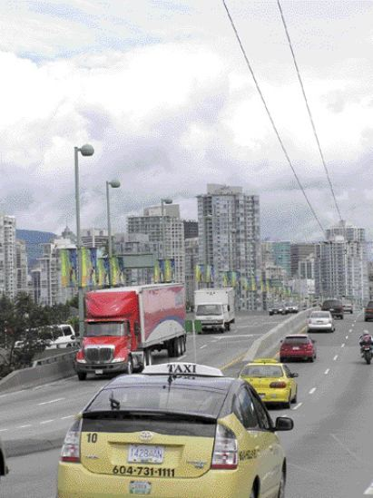 traffic on Cambie Street Bridge, leading over False Creek into the downtown. Cut-and-cover construction for the transit line tunnel will begin south of this point .